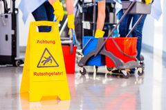 Warning sign on floor Stock Images
