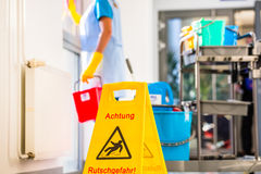 Warning sign on floor. In cleaning operation Stock Photos