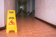 Warning sign on the floor in hotel corridor Stock Photography