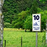 Warning sign for free range children, New Zealand royalty free stock photography