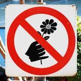 Warning sign in the garden Stock Photos