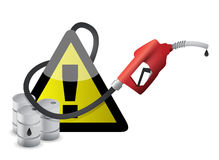 Warning sign with a gas pump nozzle Stock Image