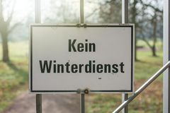 Warning sign with the German label `No winter service` at the entrance of a park stock image