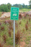 The warning sign of golf carts on paths only, for protecting gre Stock Photo