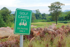 The warning sign of golf carts on paths only, for protecting gre Stock Image