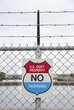 Warning sign at Great Lakes locks. SAULT STE. MARIE, MICHIGAN - OCTOBER 5, 2015: U. S. Government warning sign at Soo Locks in Michigan royalty free stock photo