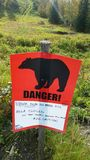 Warning sign grizzly Anchorage park Stock Photos