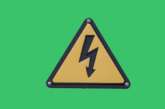 Warning sign `high voltage` on a green background Stock Images