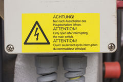 Warning sign for high voltage, Manufacturing Stock Image