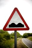 Warning Sign Humps. Warning road sign of Humps in road ahead Stock Photography
