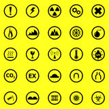 Warning sign icons on yellow background Royalty Free Stock Photos