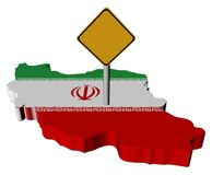 Warning sign on Iran map flag Royalty Free Stock Photography