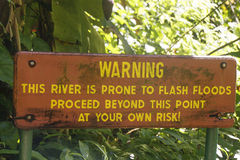 Warning Sign at Jungle River Royalty Free Stock Images