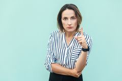 Warning sign. lady boss looking at camera with serious face and Royalty Free Stock Photography