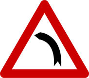 Warning sign with left bend Stock Photo