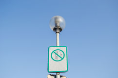 Warning sign on littering streets on street lamp. Warning information street sign the ban on littering the streets with lithuanian inscription on the street lamp Stock Images