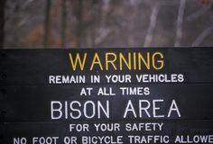Warning sign at Lone Elk Park, MT regarding Bison Royalty Free Stock Images
