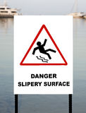 Warning sign at a marina. Slippery when wet warning sign at a marina Stock Photography