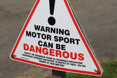 Warning sign for motor racing. Royalty Free Stock Photos