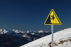 Warning sign in the mountains Royalty Free Stock Photo