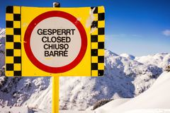 A warning sign in the mountains Stock Photo