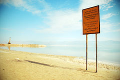 Warning sign near the sea. Warning sign on the beach Stock Photography