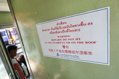 Warning sign onboard a Thai train Royalty Free Stock Photos