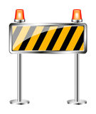 Warning sign with orange flashing siren Stock Photo