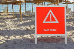 Warning Sign Paid Zone On The Summer Sea Beach Royalty Free Stock Photography
