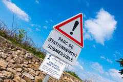 warning sign - parking one side only and liable to flooding Royalty Free Stock Image