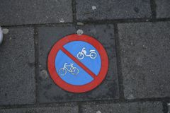 No bikes no motorcycles sign. Warning sign on pavement in Amsterdam`s street, forbids two wheel vehicles passing royalty free stock photography