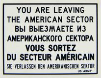 Warning sign plate, You are leaving the American sector in English, Russian, French and German languages. Warning sign plate, You are leaving the American sector stock image