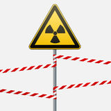 Warning sign on a pole and warning bands. Sign of radiation hazards. Vector illustration. Stock Photo