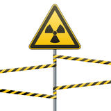 Warning sign on a pole and warning bands. Stock Photo