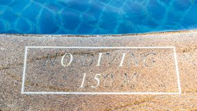 Warning sign of pool depth Royalty Free Stock Images