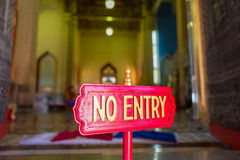 Warning sign post to not enter inside Marble temple in Bangkok,. No entry wooden sign post in Wat Benchamabophit or Marble temple in Bangkok. Selective focus Stock Photo
