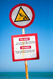 Warning sign preventing not to walk on rocks in Cartagena Stock Image