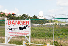 Warning sign at Princess Juliana airport Stock Images