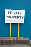 Warning sign. Private property warning sign against blue fence Royalty Free Stock Photos