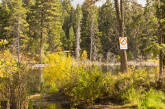 Warning sign on quiet lake Stock Photography