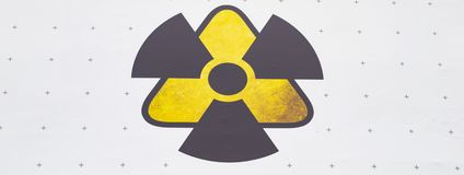 Warning sign - radiation, on a white background stock photos
