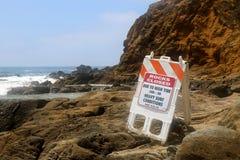 Warning sign reading rocks closed Stock Photos