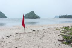 Warning sign of red flag at beautiful beach. With blue sky and sea, Krabi, south ofThailand Stock Images