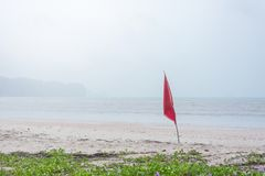Warning sign of red flag at beautiful beach. With blue sky and sea, Krabi, south ofThailand Stock Photos