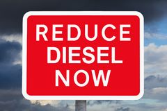 Warning sign REDUCE DIESEL NOW Stock Photo