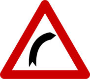 Warning sign with right bend Stock Images