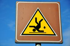 Warning sign: risk of falling. Warning sign to prevent people from falling on the stairs . Caution when stepping not to stumble.trip hazard sign Royalty Free Stock Image