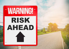 Warning sign on the road ahead say Risk Ahead. Business and risk management concept stock photography