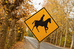 A warning sign on the road for horse riders Royalty Free Stock Photos