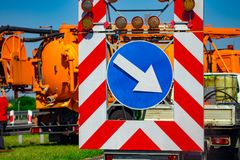 A warning sign on the road runs ahead. Road sign. Road repair.  royalty free stock photography